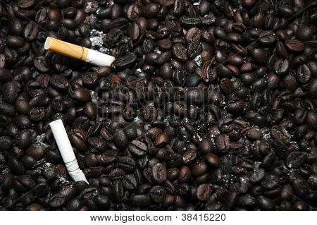 Cigarette Butts Off On A Bunch Of Fried Coffee Beans Are Used As An Ashtray