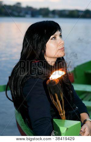 Girl in a boat ashore lake