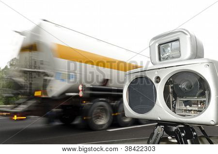 speed camera and truck on road