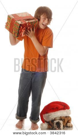 Teen Boy With Present With Dog Wearing Hat