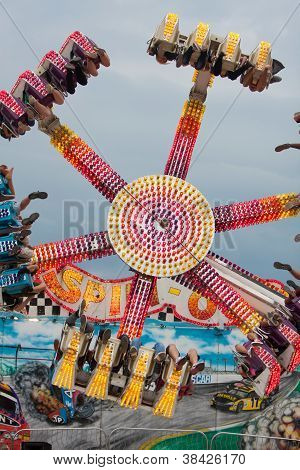 Teens Enjoy An Upside Down Carnival Ride