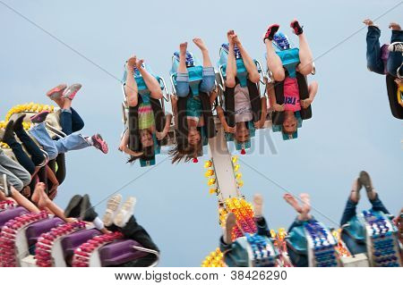 Teens Go Upside Down On Carnival Ride