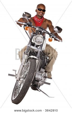 Isolated Man On Motorbike