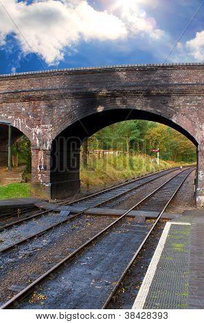 Old Brick Bridge Over A Steam Railway Track