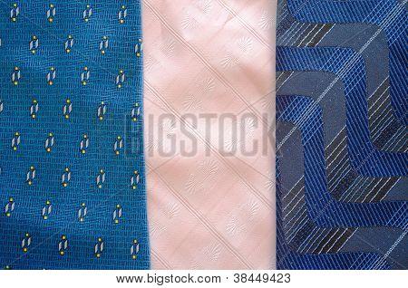 Three Cravat Tie Scarfs Texture Pattern Background