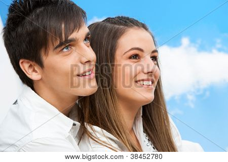 Close Up Portrait Of Teen Couple Outdoors.