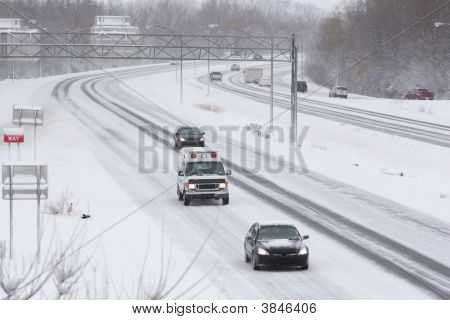 Traffic On Expressway During Winter Snow Storm