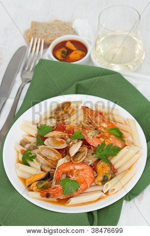 Pasta With Seafood On The Plate And White Wine