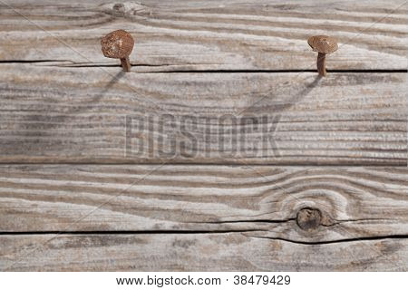 Old Wooden Planks And Two Rusty Nails