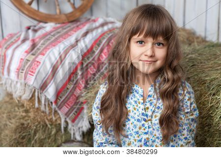 Portrait Of Girl Villager In Wooden Hayloft With Vintage D�cor