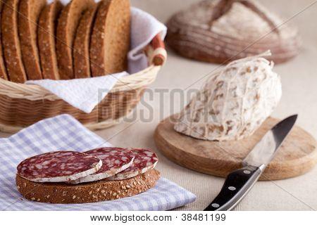 Served Kitchen Table, Sandwich On Napkin, Salami, Breadbasket, Sliced Bread