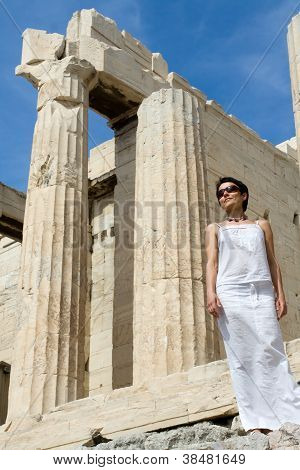 Woman Near Propylaea Columns Acropolis Athens Greece On Sky Background