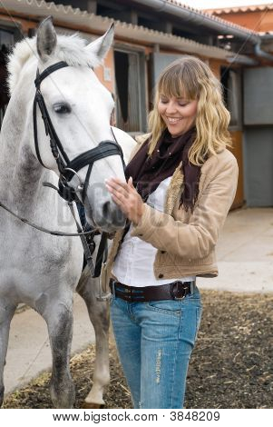 Woman Laughing With A White Horse