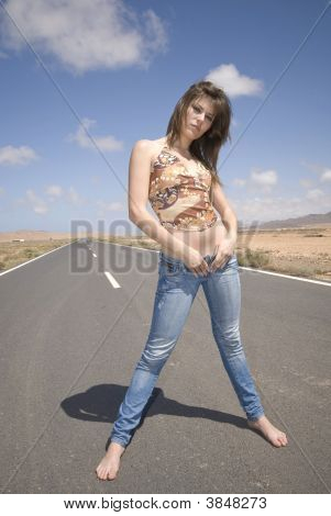 Woman In The Road With Jeans