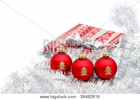 Three Red Christmas Ball And Present On White Background