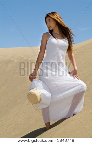 Beautiful Woman In White In The Desert Dunes