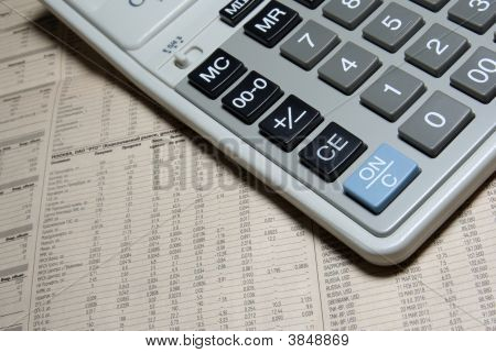 Calculator Keypad And Financial Newspaper. Business Concept Photo.