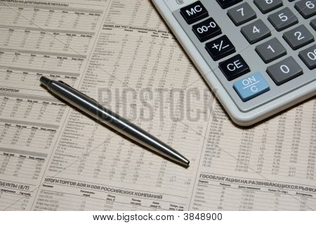 Professional Calculator, Steel Pen And Financial Newspaper. Business Concept.
