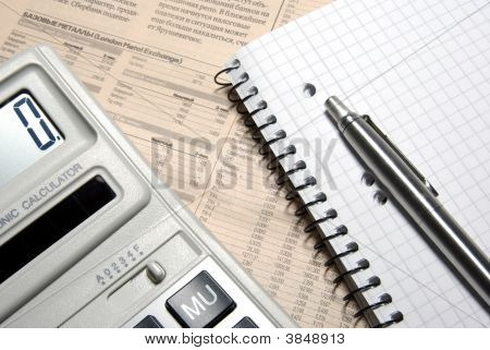 Calculator, Pen, Notebook And Financial Newspaper. Conceptual.