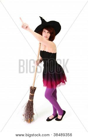 Halloween Witch With A Broom And Pointing Finger Up Isolated Over White Background
