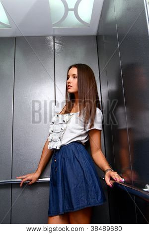 Young Business Woman In An Elevator