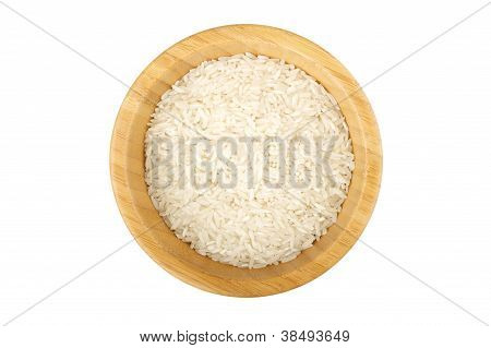 Bamboo Bowl Partially Filled With Raw Rice