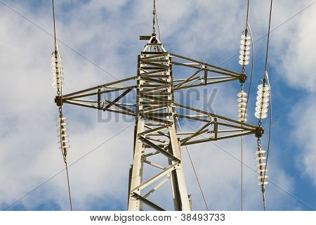 High Voltage Pole From Below Against Blue Sky