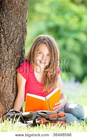 Happy Student Girl Reading Book