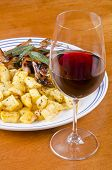stock photo of rutabaga  - Barbecued quails served with roasted rutabaga and a glass of Pinot Noir - JPG