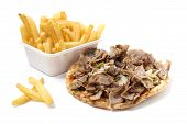 pic of splayed  - roasted meat on tortilla with french fries on white background - JPG