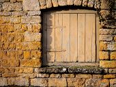 Small Wooden Door In A Stone Wall