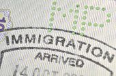stock photo of fragmentation  - immigration control passport stamp fragment - JPG