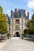 Medieval Royal Castle Fontainbleau Near Paris In France And Garden