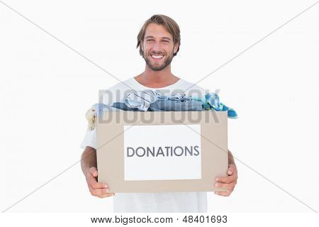 Happy man carrying donation box on white background