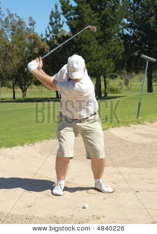 Golfer In The Sand Bunker