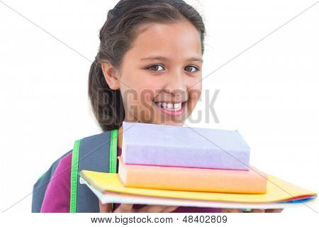 Little girl wearing book bag and holding her homework in white background