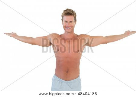 Attractive man opening his arms on white background