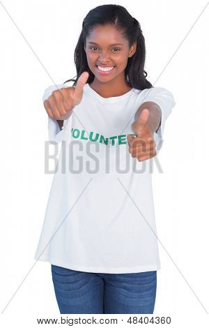Young woman wearing volunteer tshirt and giving thumbs up on white background