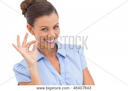 Sophisticated businesswoman saying ok with fingers