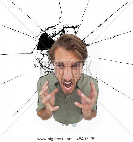 Riled man gesturing and yelling with impact on the background