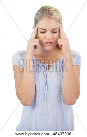 Unsmiling young woman has a headache on white background