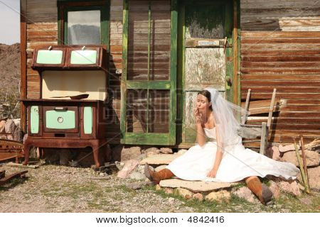 Smoking Bride In Front Of A Run Down Shack