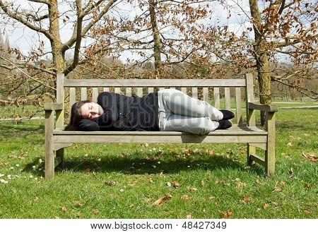 Small quiet nap on a bench