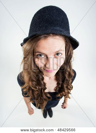 Cute Girl With Funny Peasant Hat Smiling In The Studio