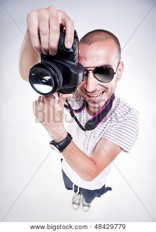 Funny Photographer Posing With A Camera Smiling