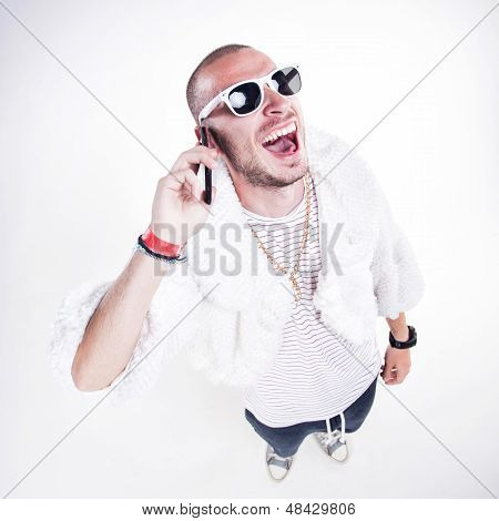 Funny Guy Wearing Fur And Hipster Glasses While Laughing Hard On The Phone