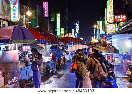 TAIPEI, TAIWAN - JANUARY 12: Pedestrians at a night Market at Guangzhou Street January 12, 2013 in Taipei, TW. Night markets are an important part of the culinary culture of Taipei.