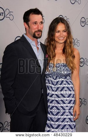 LOS ANGELES - JUL 24:  Noah Wyle, Moon Bloodgood arrives at TNT's 25th Anniversary Party at the Beverly Hilton Hotel on July 24, 2013 in Beverly Hills, CA