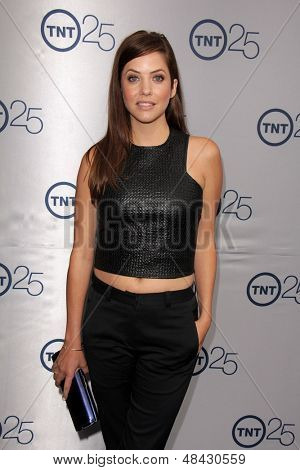 LOS ANGELES - JUL 24:  Julie Gonzalo arrives at TNT's 25th Anniversary Party at the Beverly Hilton Hotel on July 24, 2013 in Beverly Hills, CA