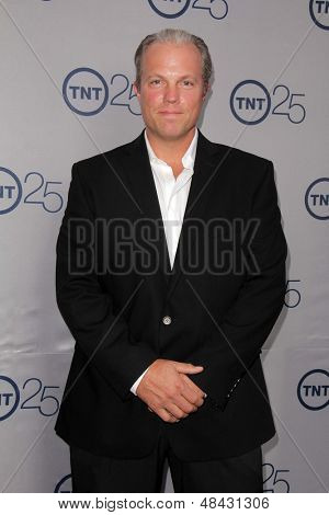 LOS ANGELES - JUL 24:  Adam Baldwin arrives at TNT's 25th Anniversary Party at the Beverly Hilton Hotel on July 24, 2013 in Beverly Hills, CA